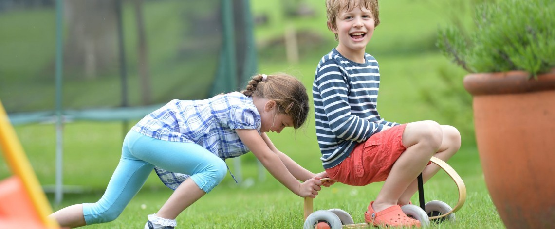 Children play in the gardens at Hampshire hotel New Park Manor