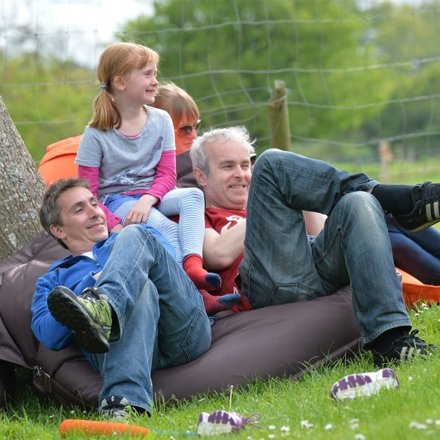A family relaxes in the garden at New Park Manor
