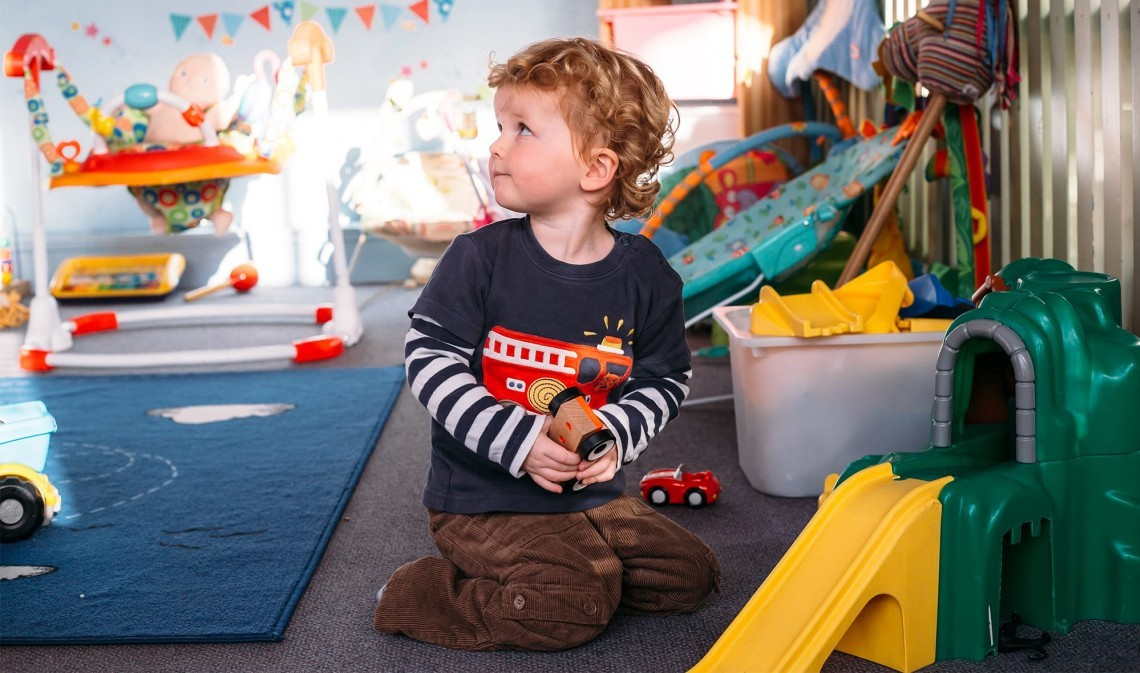 A child playing at the crèche at New Park Manor – a luxury family hotel in the New Forest