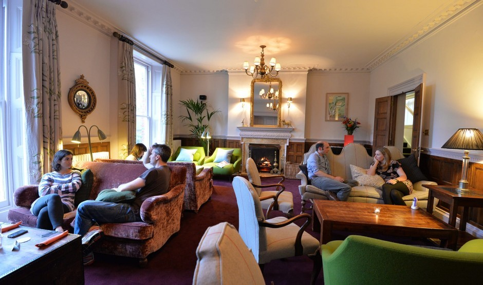 Guests enjoying the period style lounge at historic house New Park Manor