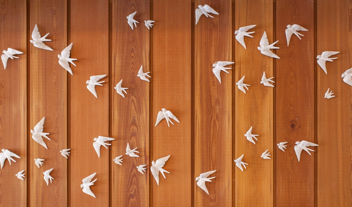 In the Spa Café of luxury family hotel New Park Manor, white birds adorn the wooden wall