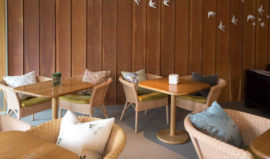 The Spa Café at luxury family hotel New Park manor in Worcestershire has simple, comfortable chairs and beautiful décor