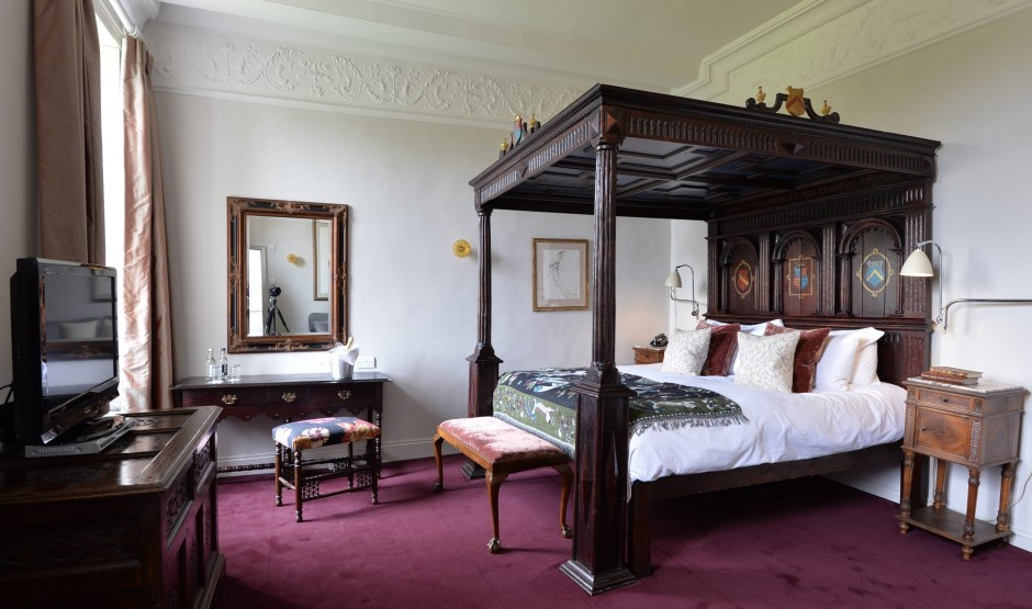 Four-poster hotel room at New Park Manor in Hampshire