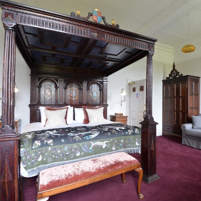 Four-poster hotel room in the New Forest