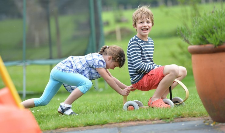 Children play games outdoors at New Park Manor