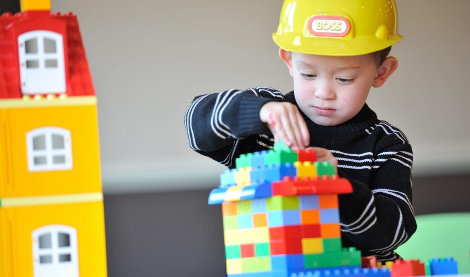 Toddler plays with toys at child-friendly hotel New Park Manor